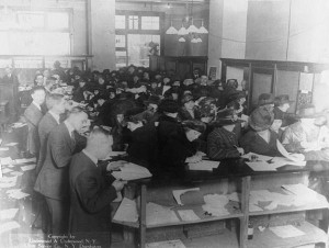 People filing tax forms in 1920