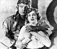 Rudolph Valentino as Sheik Ahmed and Agnes Ayres as Lady Diana